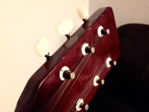 Use the tuning pegs to alter the pitch of the open string